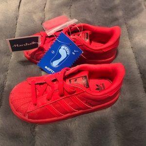 Adidas supertars (shell toe).